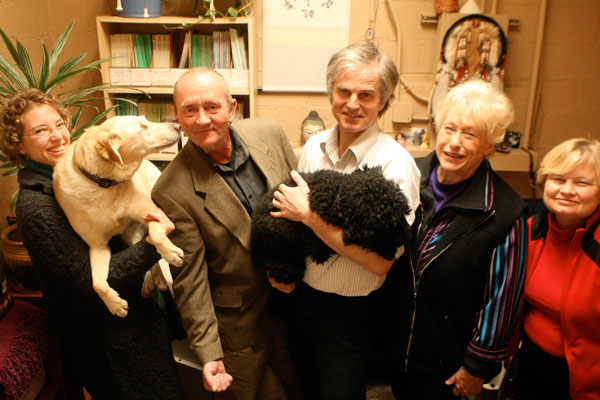 Johanna Altgelt, Kirk Turner, Michael McCulloch, Kathy O'Brien, and Jett Gulbronsen pose with Tessy and Captain Jennings at the Pine Street Foundation in San Anselmo, California